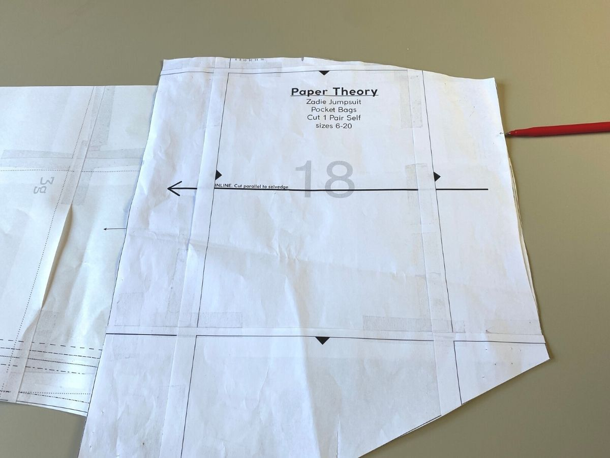 Aligning the waistline points on the pocket and pants pattern to mark the opening notch