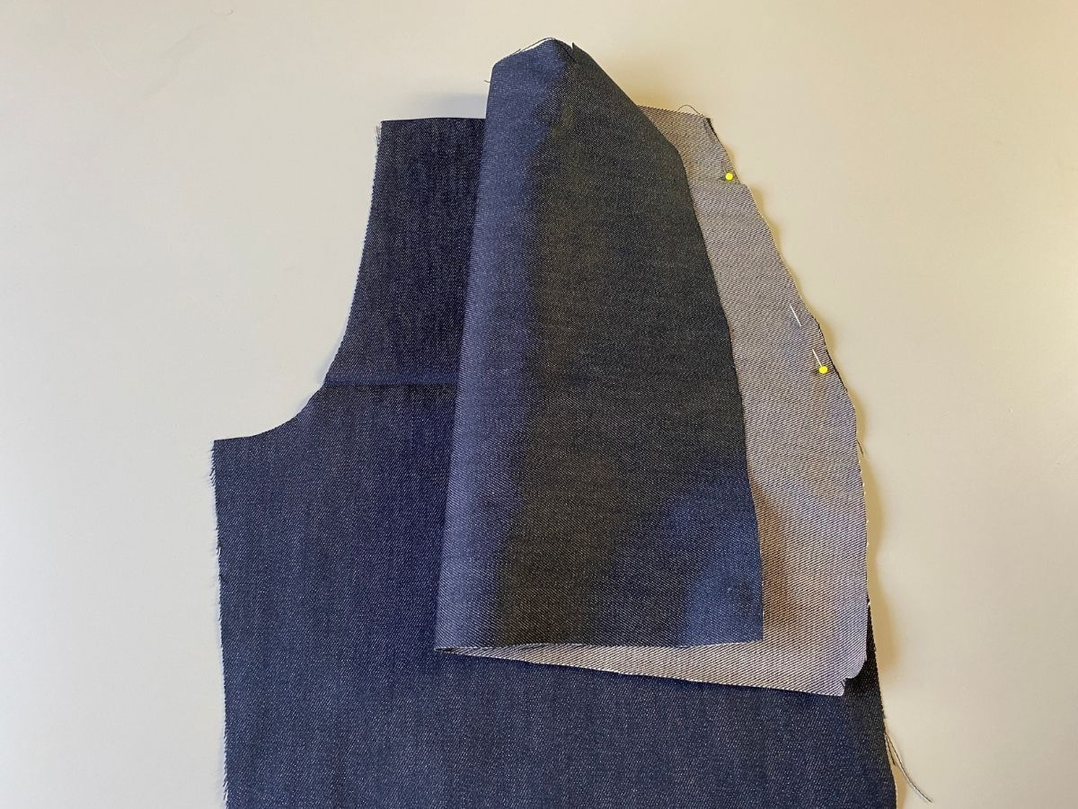 Pinning the pocket pattern pieces right sides together with the front pants pieces.