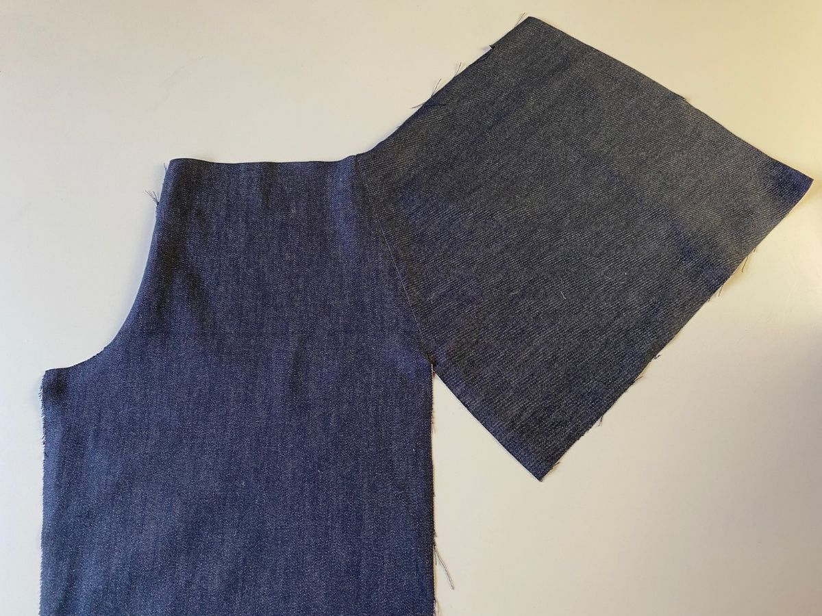 The pocket pattern piece stitched to the pants front piece.