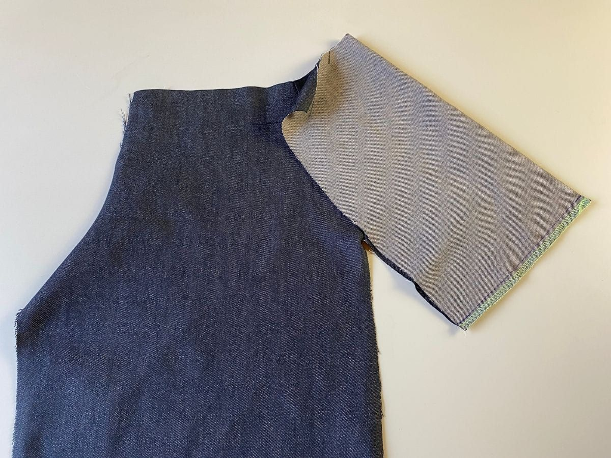 The pocket seam stitched together, attached to the pants front piece