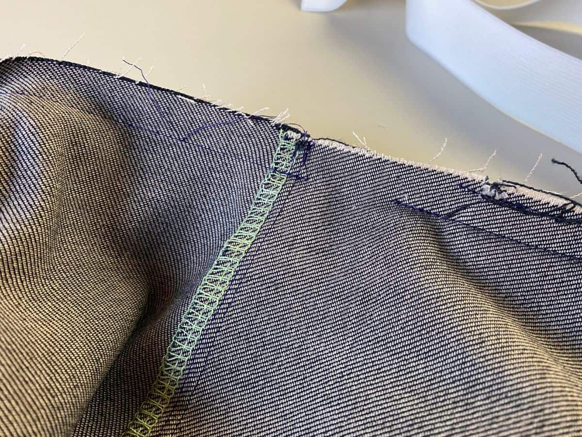 Stitching together the waistband seams, leaving a small opening