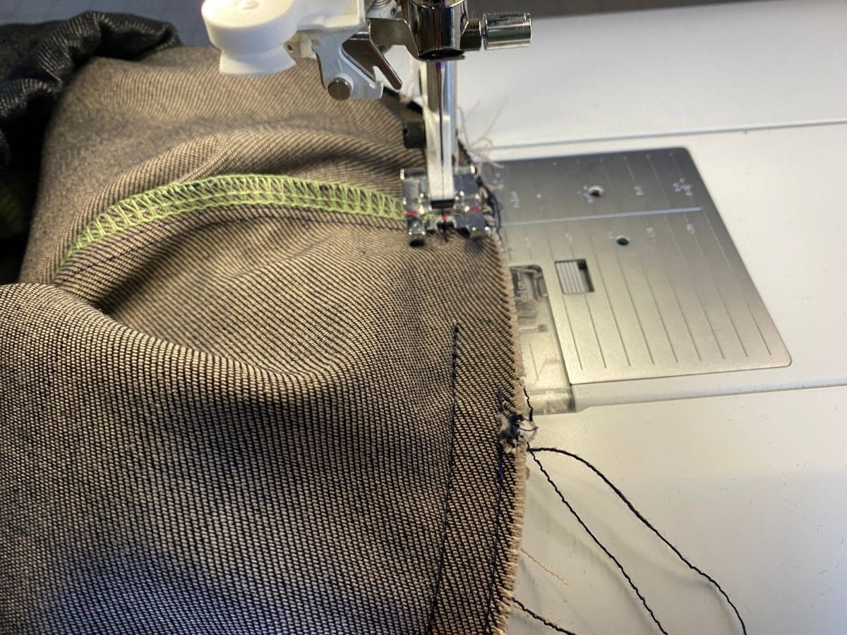 Stitching closed the waistband seam of the Pagosa Pants