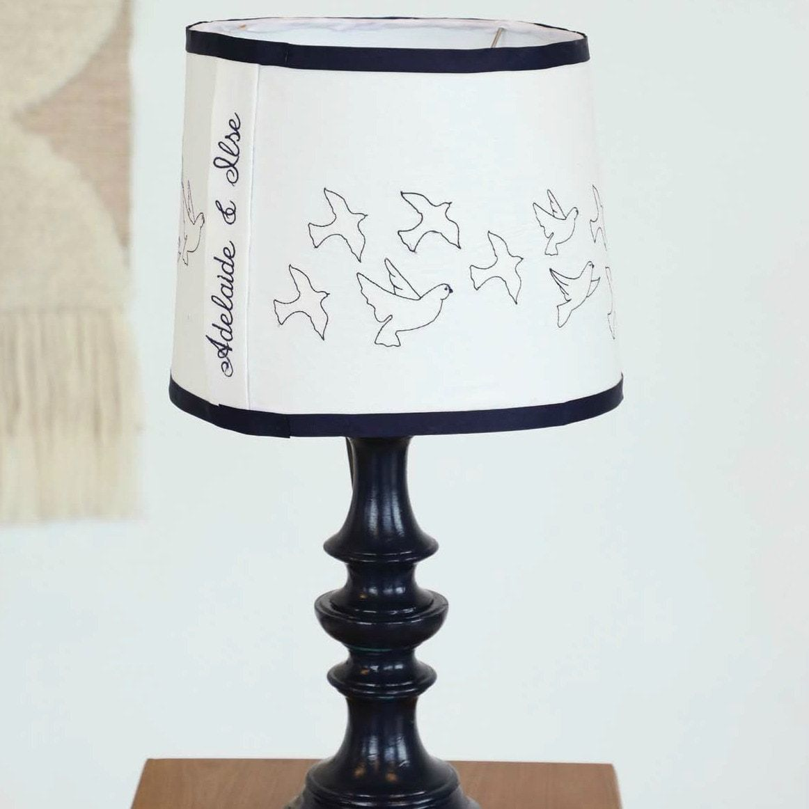 Handmade lampshade decorated with doves and a custom monogram machine embroidery.