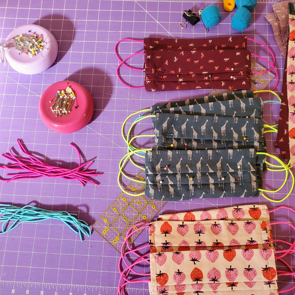 Fabric, elastic and more shown for making handmade masks